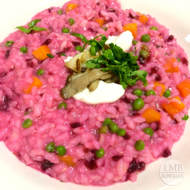 Beet risotto with goat cheese, carrots, and peas