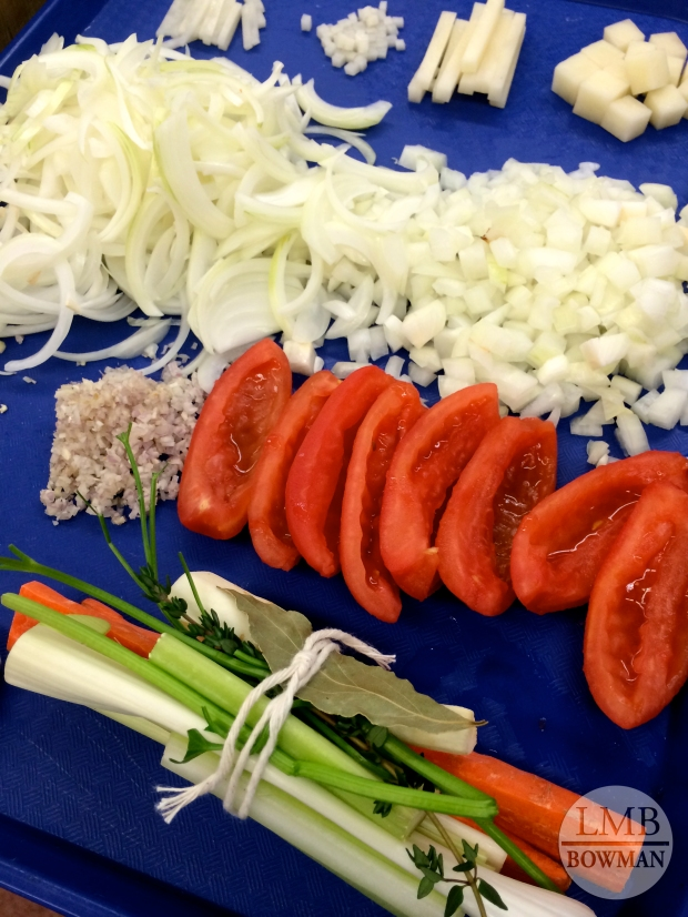 Knife tray: bouquet garni; minced shallot; minced garlic; tomato concasse; diced and sliced onions; diced potatoes, potato batonnets, julienne of potato and brunoise of potato