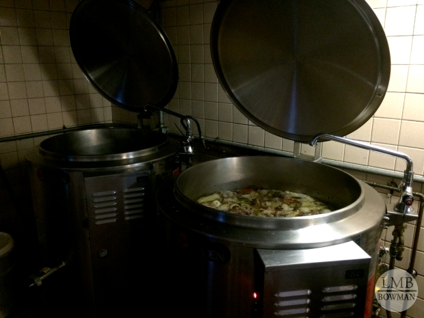 Kettles simmering with chicken and beef stock