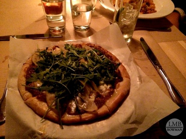 I loved this pizza...they made it in a wood oven so the crust was perfect.  It was topped with a fig spread, goat cheese, roasted pears, arugula and finished with truffle oil.