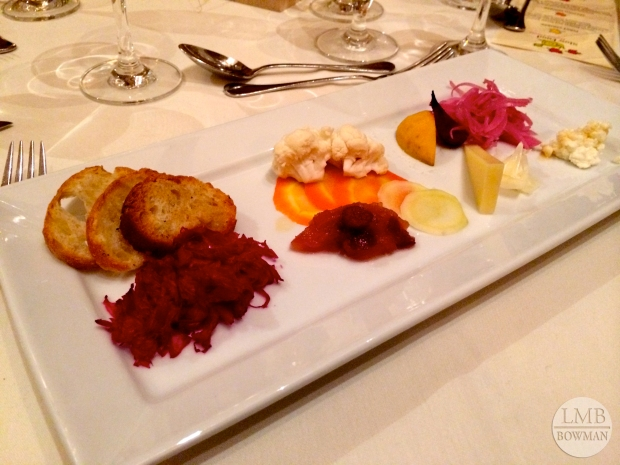 "The first course was called ""Seven Sweets and Seven Sours."" It included pickled vegetables, cheeses and preserves."