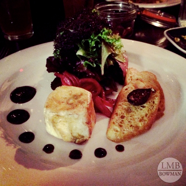 Phyllo wrapped goat cheese salad with baby lettuces, fig jam, grenadine marinated onions, and a garlic crostini.