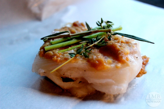 Miso glazed haddock baked in parchment paper with herb stems