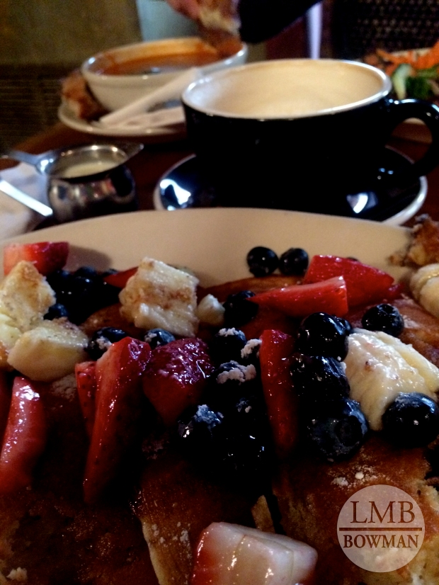 Blueberry pancakes and fresh fruit