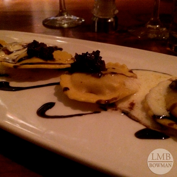 Butternut squash and ricotta ravioli with onion jam and a balsamic reduction