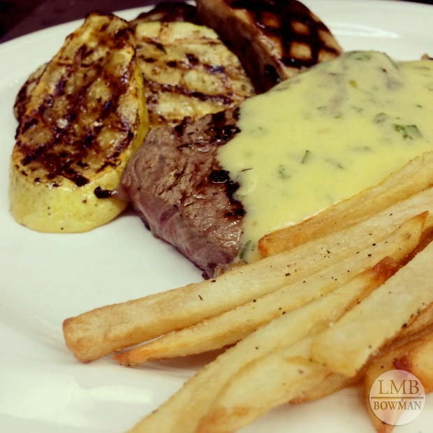 Steak frites: grilled steak with Bearnaise sauce, grilled vegetables and French fries