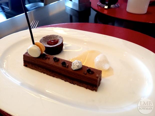 Deconstructed chocolate, hazelnut, and blood orange dessert.